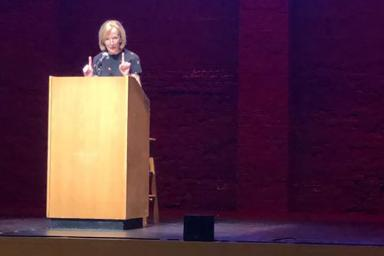 Judy Woodruff speaks at a podium