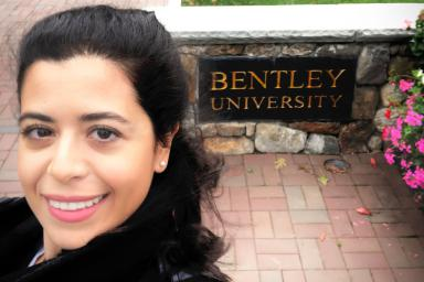 A selfie of Julide Etem in front of a Bradley University sign