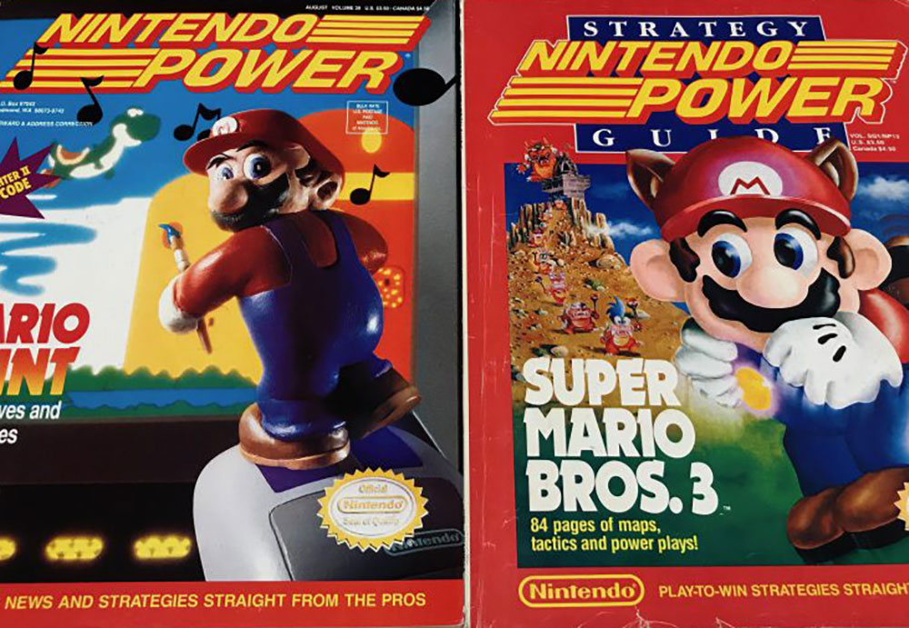 "Two issues of ""Nintendo Power."" The first says ""Mario Paint: Music, Moves and Masterpieces. The Source for News and Strategies Straight from the Pros."" The second says ""Nintendo Power Strategy Guide. Super Mario Bros. 3. 84 pages of maps, tactics and power plays! Nintending: Play-to-Win Stragegies Straight From the Pros."""
