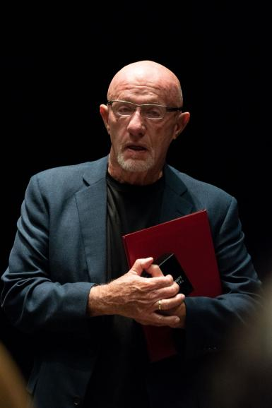 Jonathan Banks holding a binder and a box that contains the Bicentennial Medal