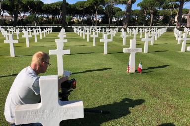 A cameraman in a cemetery