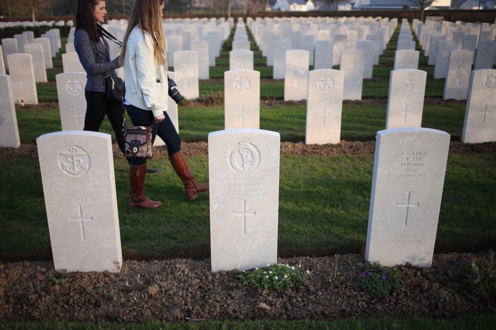 Kasey Chronis and Molly Jirasek walking through the British D-Day cemetery.