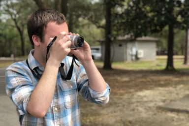 Spencer Bowman taking a photograph