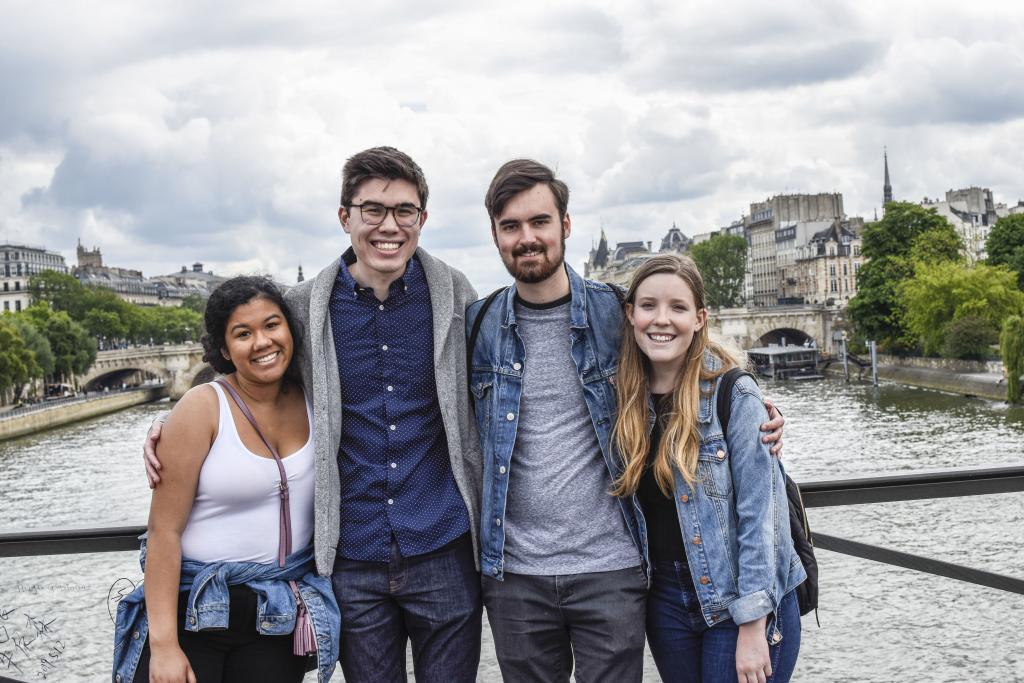 Jaden Amos, Jacob DeCastro, Sam House and Haley Klezmer standing on a bridge in Paris