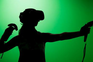 A woman playing a virtual reality video game