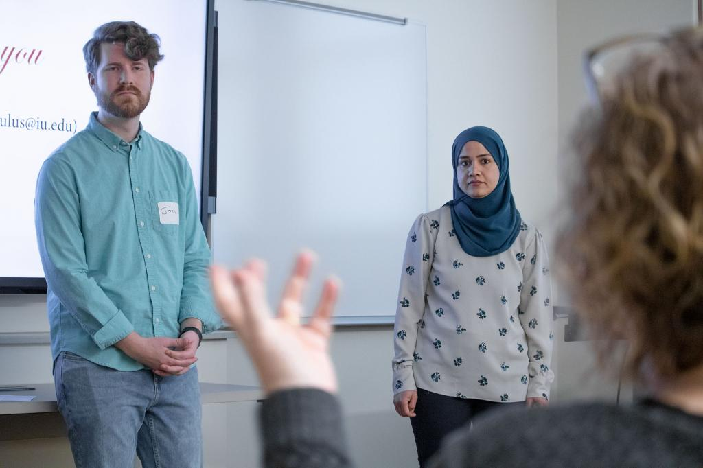 "Media School doctoral candidate Josh Sites and School of Education doctoral candidate Zawan Al Bulushi listen as an audience member asks a question during the paper session, ""Mediating Sight, Hearing and Touch,"" during the 2019 Common Ground conference."