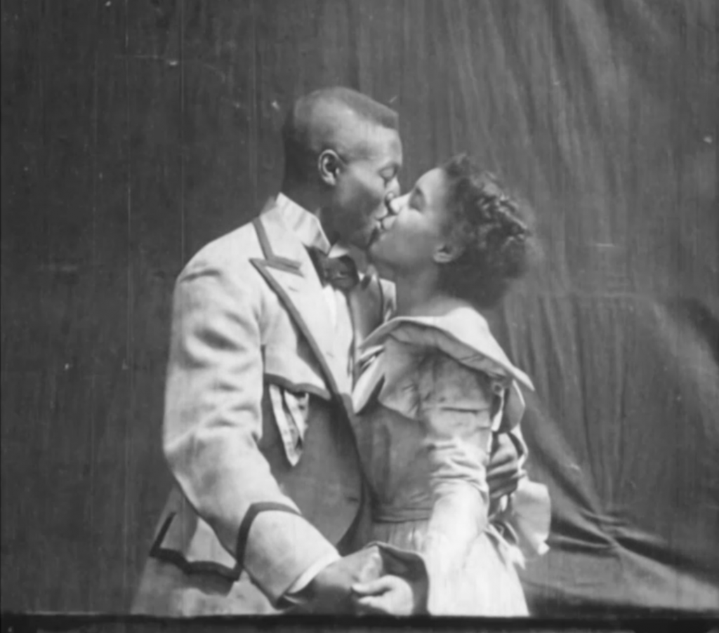 Two people kissing
