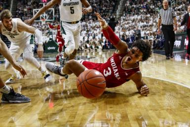 Sophomore forward Justin Smith loses the ball against Michigan State on Feb. 2 at Breslin Student Events Center in East Lansing, Michigan. Smith scored 13 in IU's 79-75 win over MSU.