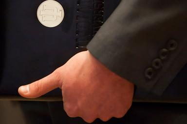 A hand holding a portfolio