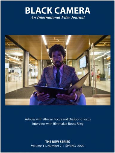 The front cover of Black Camera: An International Film Journal. It features a photo of Boots Riley looking at a binder. Text says: Articles with African Focus and Diasporic Focus. Interview with filmmaker Boots Riley. The New Series. Volume 11, Number 2. Spring 2020.