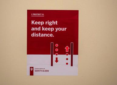 """A sign that says """"Keep right and keep your distance"""""""