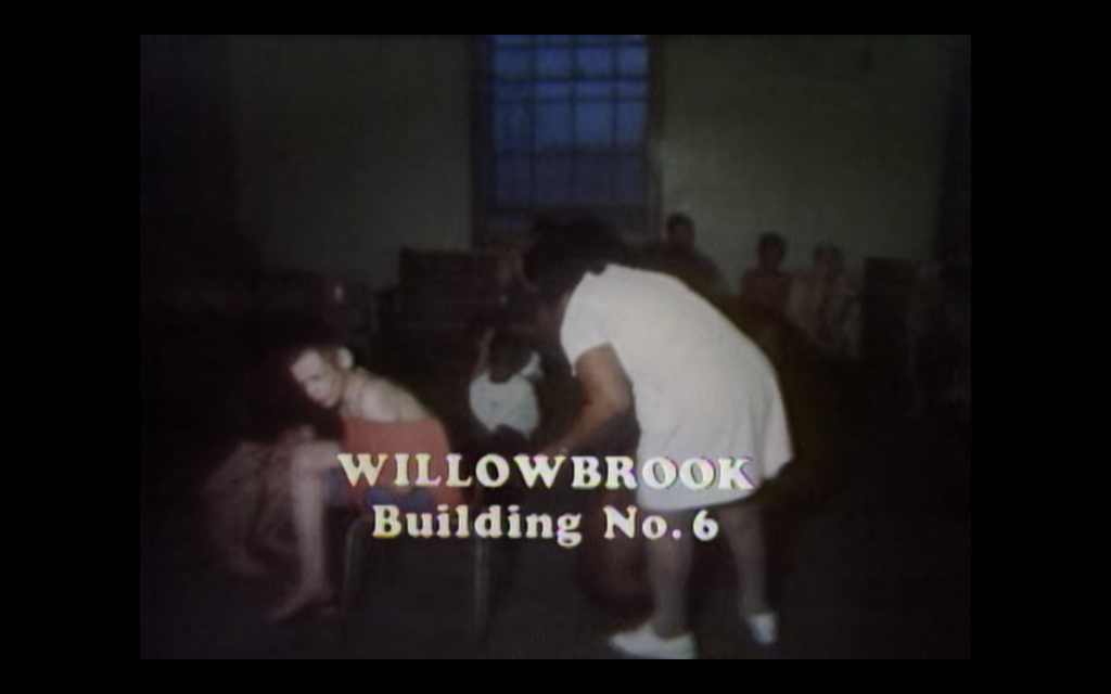 Children tied to chairs. Text says: Willowbrook Building No. 6