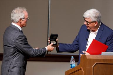 "Shanahan, right, presents Scott Pelley, correspondent for ""60 Minutes,"" with an IU Bicentennial Medal after Pelley delivered the keynote address at the Arnolt Center launch in 2019."