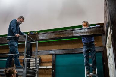 Craig Erpelding and Steve Krahnke raising a beam for the new soundstage.