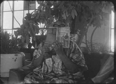 Terri Francis reading a book