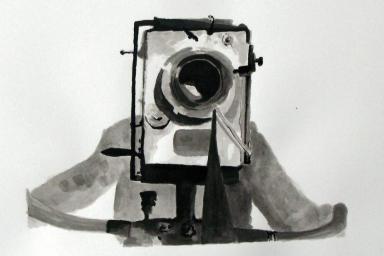 A person behind a camera