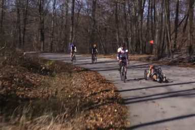 Four cyclists are pictured riding through a curve in Griffy. Tom Morris hand cycles.