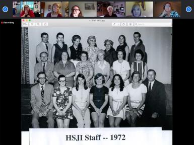 """A black-and-white group photo labeled """"HSJI Staff -- 1972"""" is displayed on a Zoom call."""