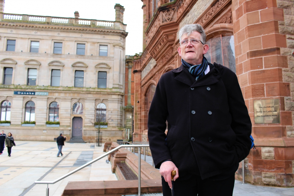 Jon McCourt stands in front of the Guildhall in Derry, Northern Ireland