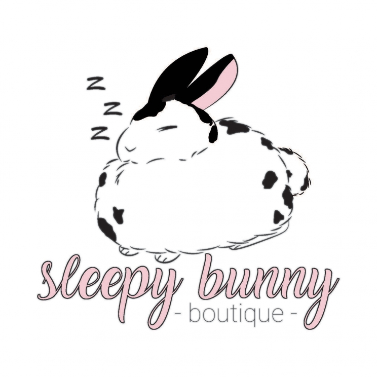 "An illustration of a sleeping rabbit with the words, ""Sleepy Bunny Boutique"""