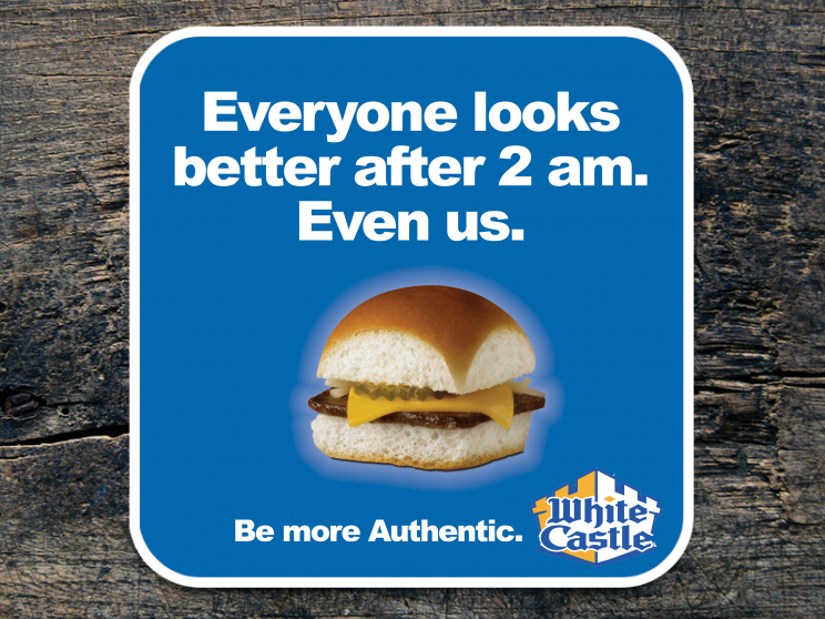 """A White Castle advertisement. It depicts a White Castle hamburger with the text: """"Everyone looks better after 2 am. Even us. Be More Authentic."""""""